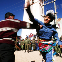 Bolivian men and women in violent harvest festival punch up, in pictures