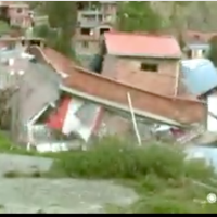 Homes collapse down hill in landslide